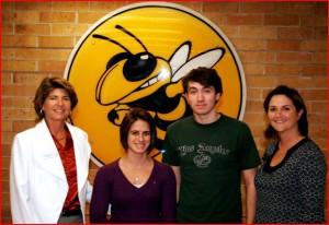 Ms. Mittelstadt and Ms. Sapp congratulate students Nicole Santoriello and Yannick Trapman-O'Brien