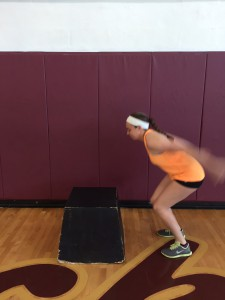 Place feet shoulder width apart, squat down and swing arms back to create momentum